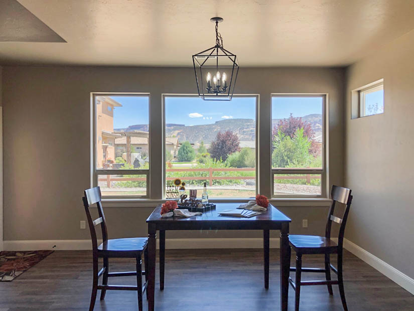 The dining room of 1484 Shoreline Drive has an incredible view of Independence Rock & the Colorado National Monument.